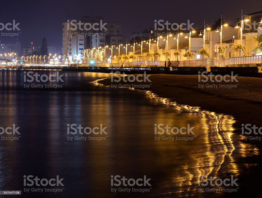 Golden night on Larnaca seafront with reflection,Cyprus stock photo