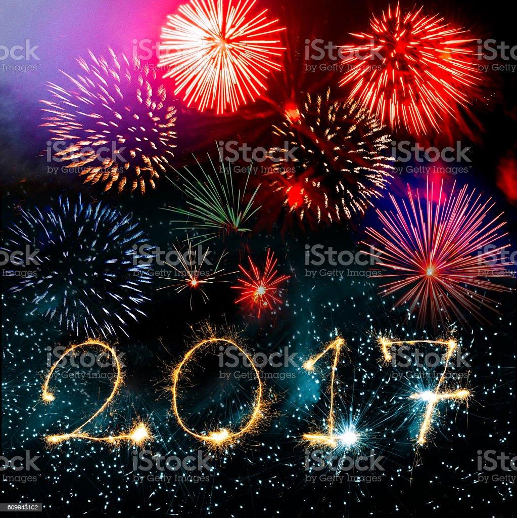 golden number 2017 sparks on vibrant fireworks background stock photo