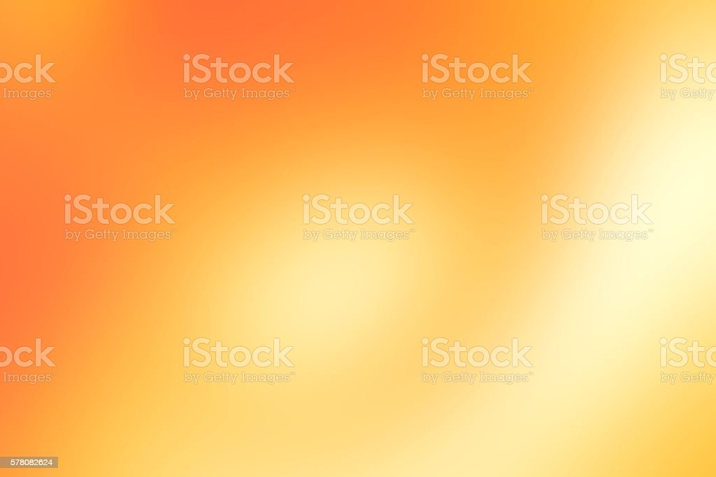 Golden orange colored blurred background stock photo