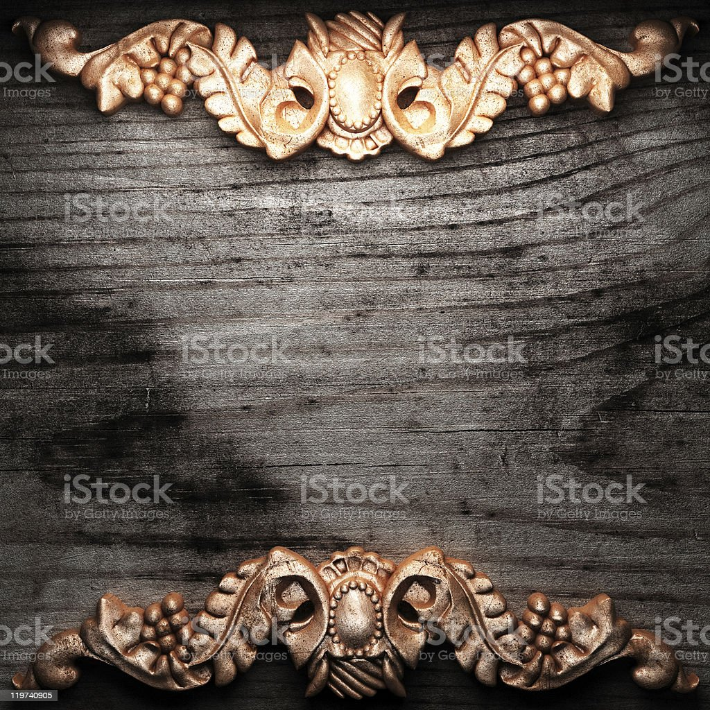 golden ornament on wood royalty-free stock photo