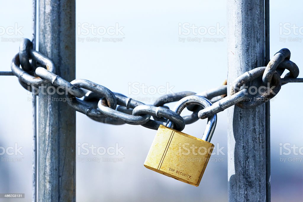 Golden Padlock and chain with copy space stock photo