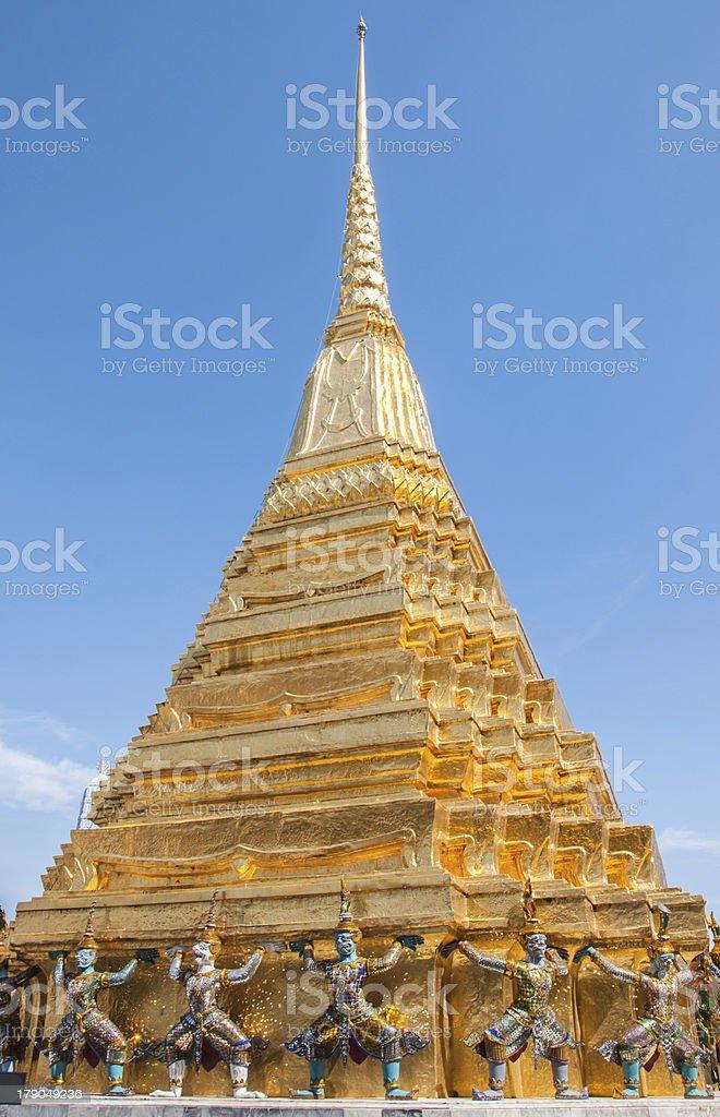 Golden pagoda with guard demon at Royal Palace, Bangkok, Thailan royalty-free stock photo