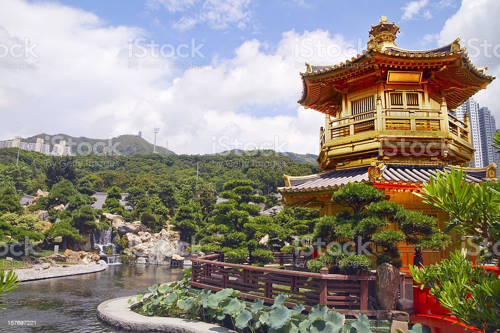 A golden pavilion temple with lotus pond in front stock photo