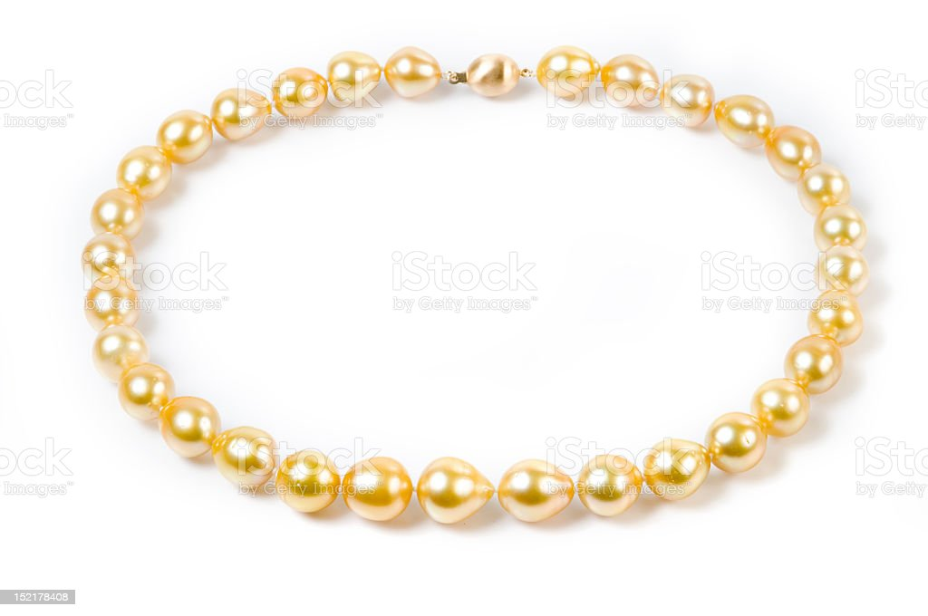 Golden Pearl Necklace on a White Background royalty-free stock photo