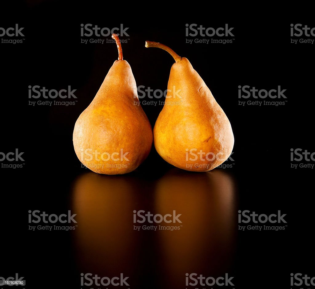 Golden Pears on Black Background stock photo