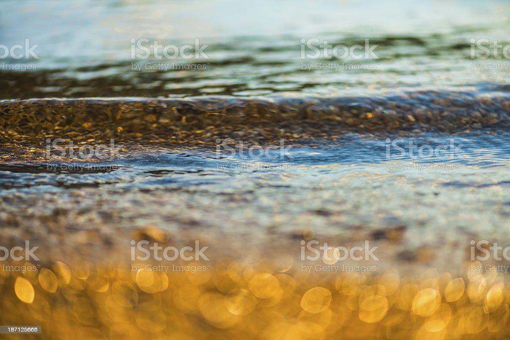 Golden pebbles at beach royalty-free stock photo