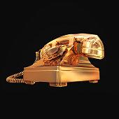 Golden phone on black isolated background.