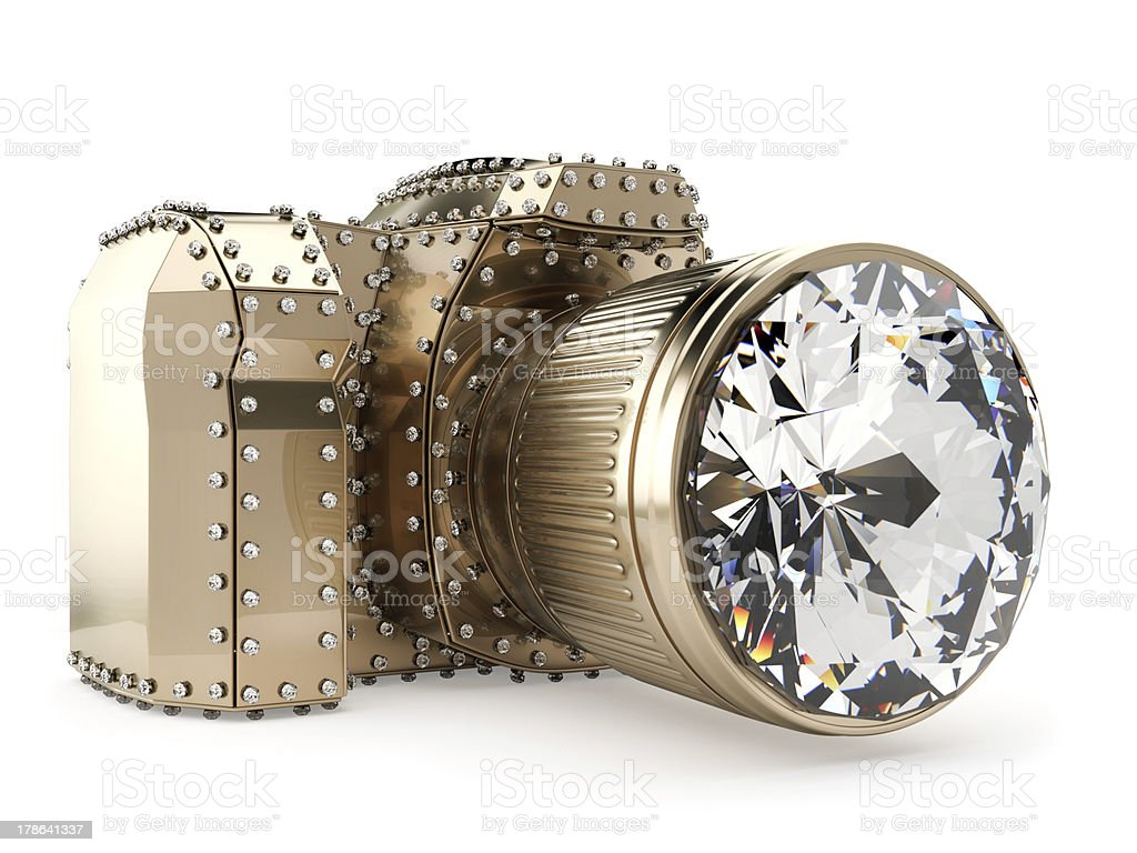 golden photo camera with diamonds isolated on white royalty-free stock photo