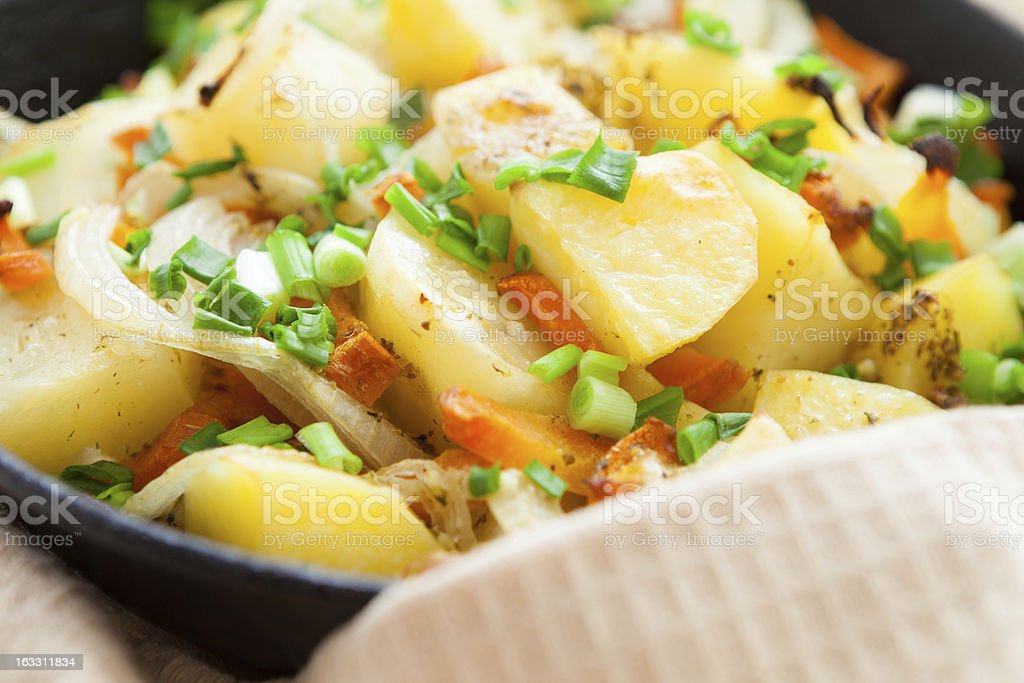 golden pieces of fried potatoes in pan royalty-free stock photo