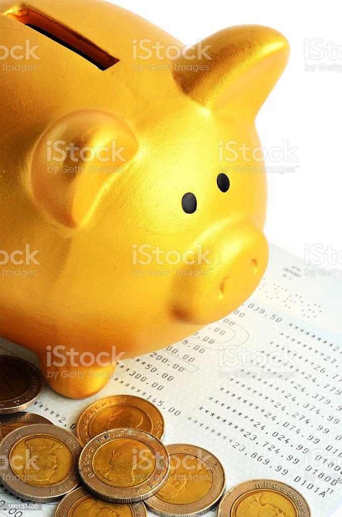 Golden Piggy Bank and Saving Passbook royalty-free stock photo