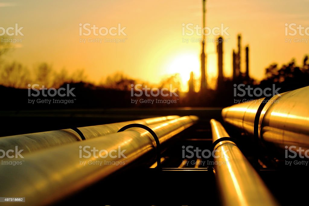 Golden pipes going to oil refinery stock photo