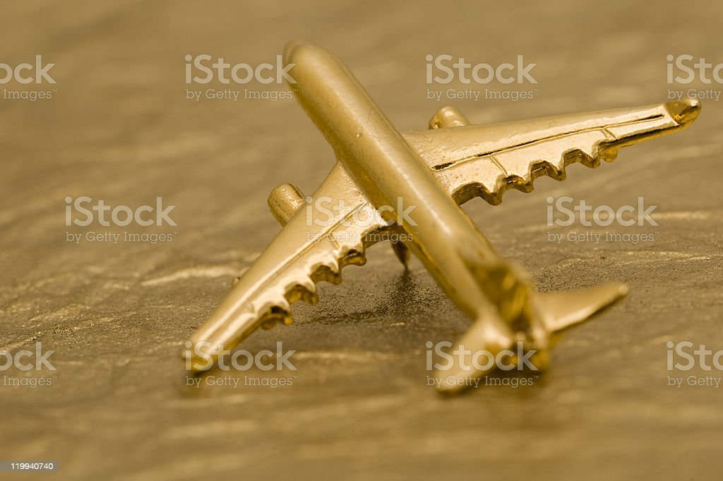 Golden Plane on Gold Foil Background stock photo