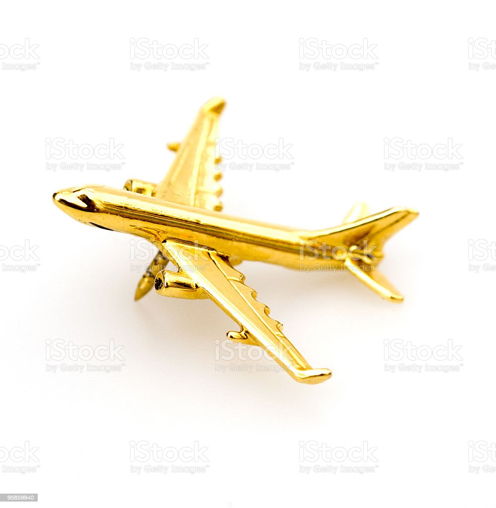 Golden Plane Pin stock photo
