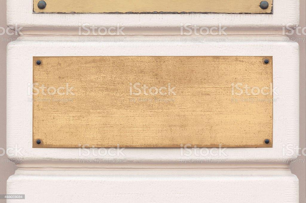 Golden plaque sign stock photo