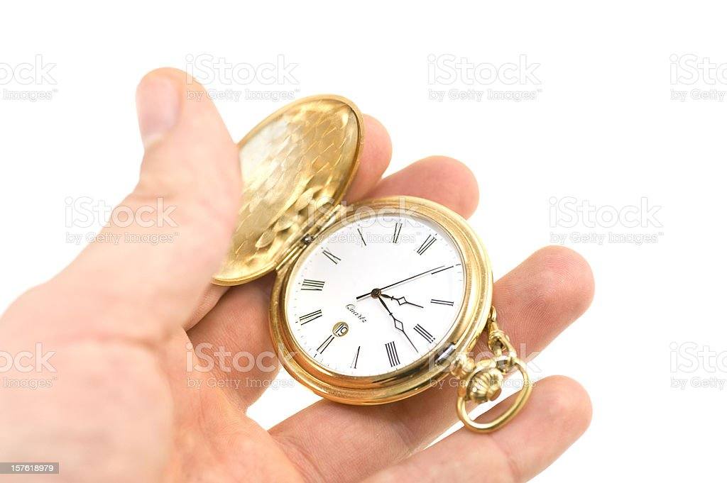 golden pocket watch in hand royalty-free stock photo
