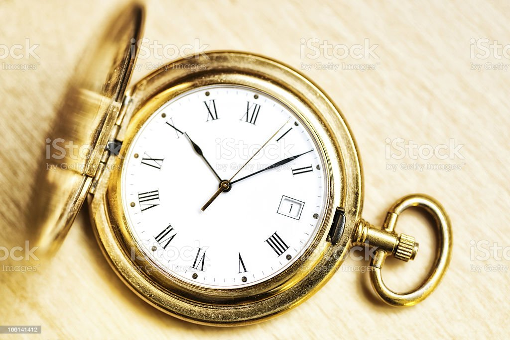 golden pocket watch with roman numbers royalty-free stock photo