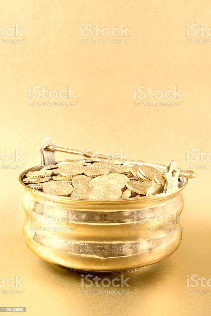 Golden pot full with coins stock photo