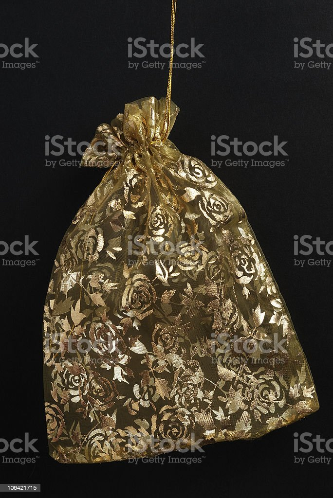 golden pouch on black royalty-free stock photo