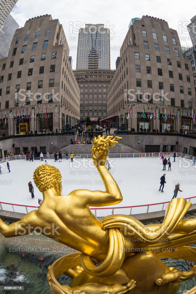 Golden Prometheus statue and Rockefeller Center ice skate rink, Manhattan, New York City, USA. stock photo