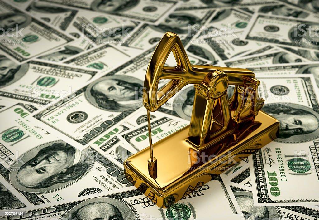 Golden Pumpjack On The Money stock photo