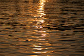 Golden ray of light over water