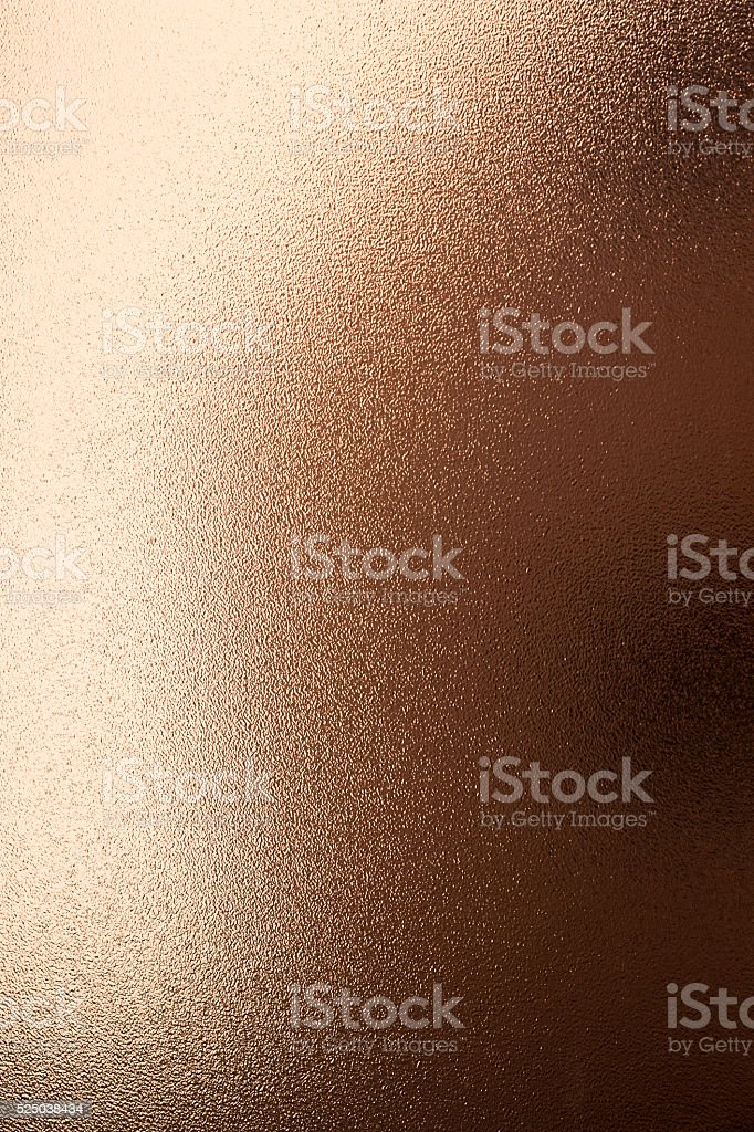 golden reflections on grained  texture surface stock photo
