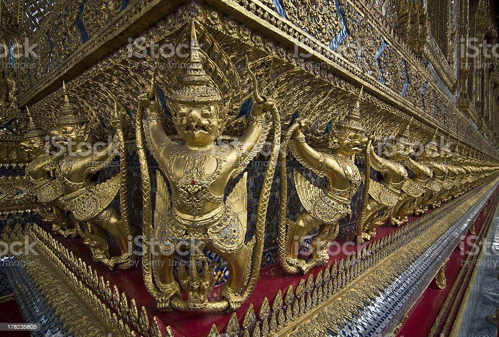 Golden Religon figures in The Royal Palace stock photo