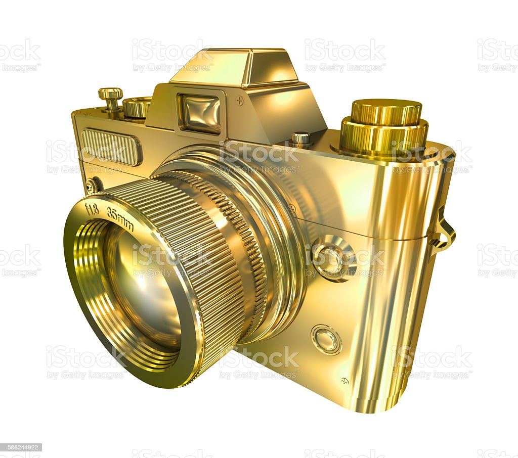 Golden retro photo camera on a white background stock photo