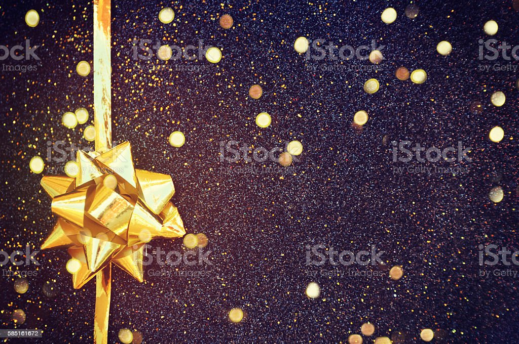 Golden ribbon bow with bokeh,Christmas decoration stock photo