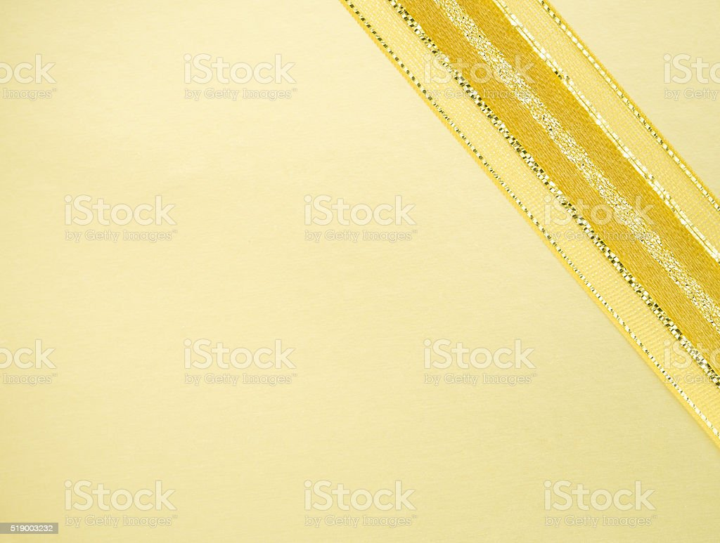 Golden ribbon on yellow space stock photo