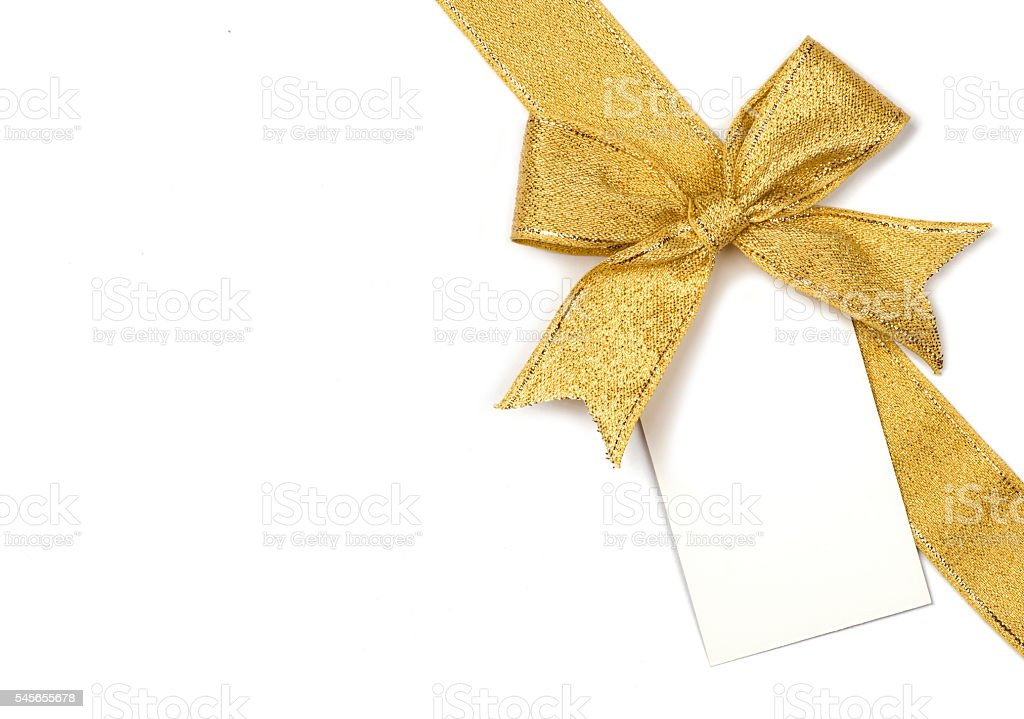 Golden ribbon with bow and card stock photo