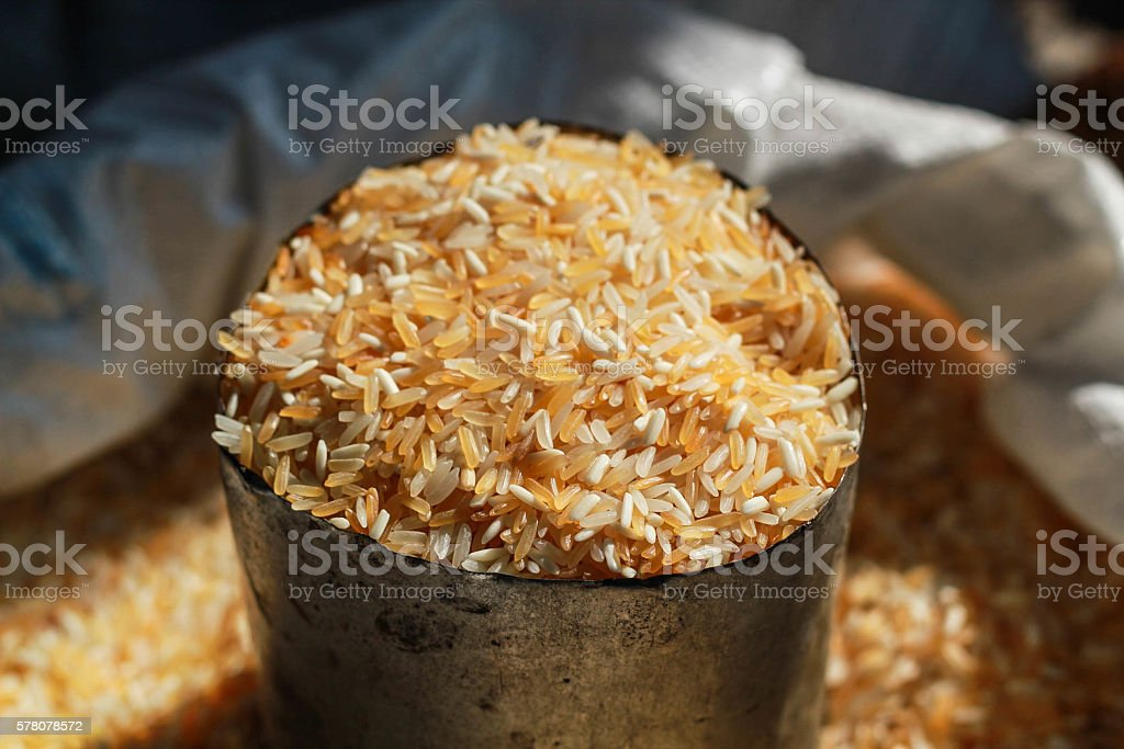 Golden rice in cup royalty-free stock photo