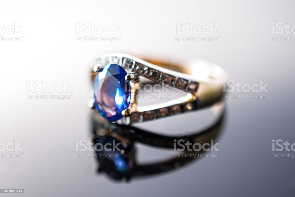 Golden ring with blue ruby in close up photo stock photo
