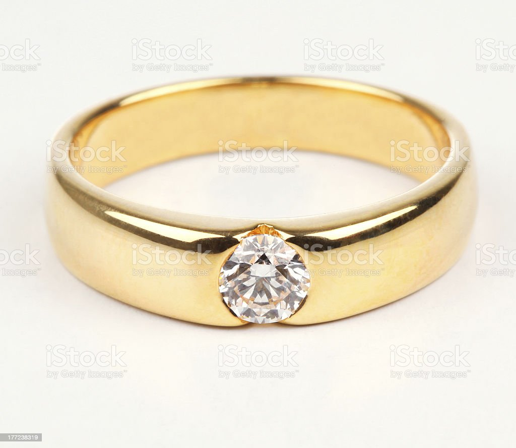 Golden Ring with Diamond isolated on white background. stock photo