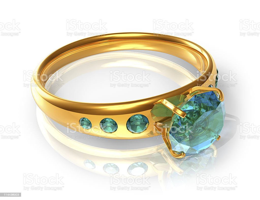 Golden ring with emeralds royalty-free stock photo