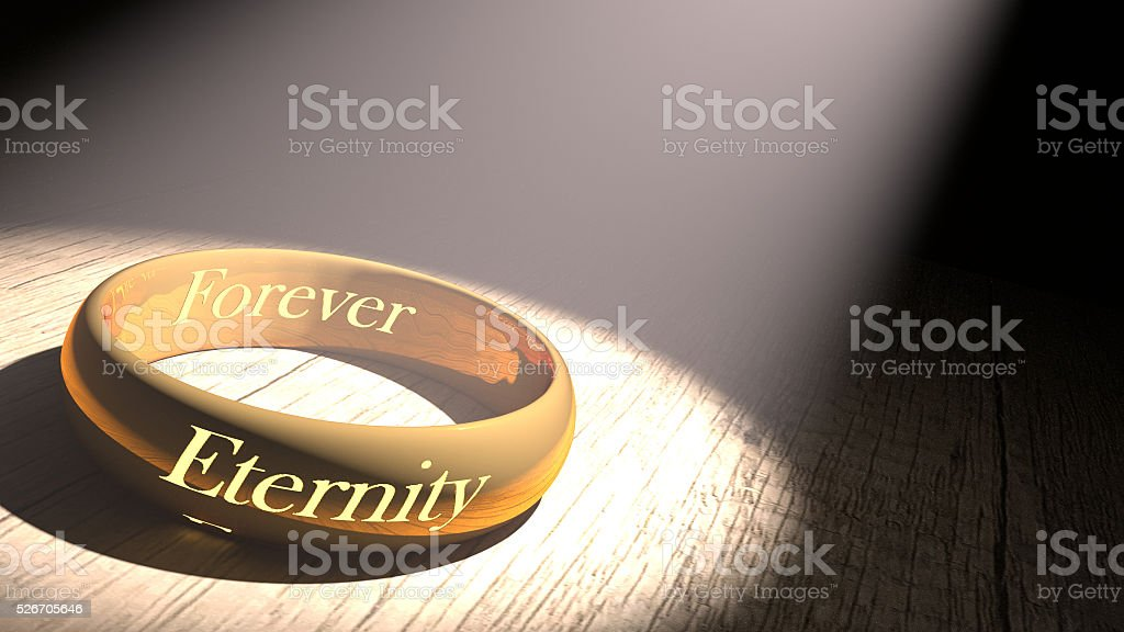 Golden ring with eternity engraved stock photo