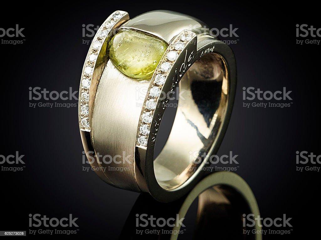 Golden ring with gemstone isolated on black background stock photo