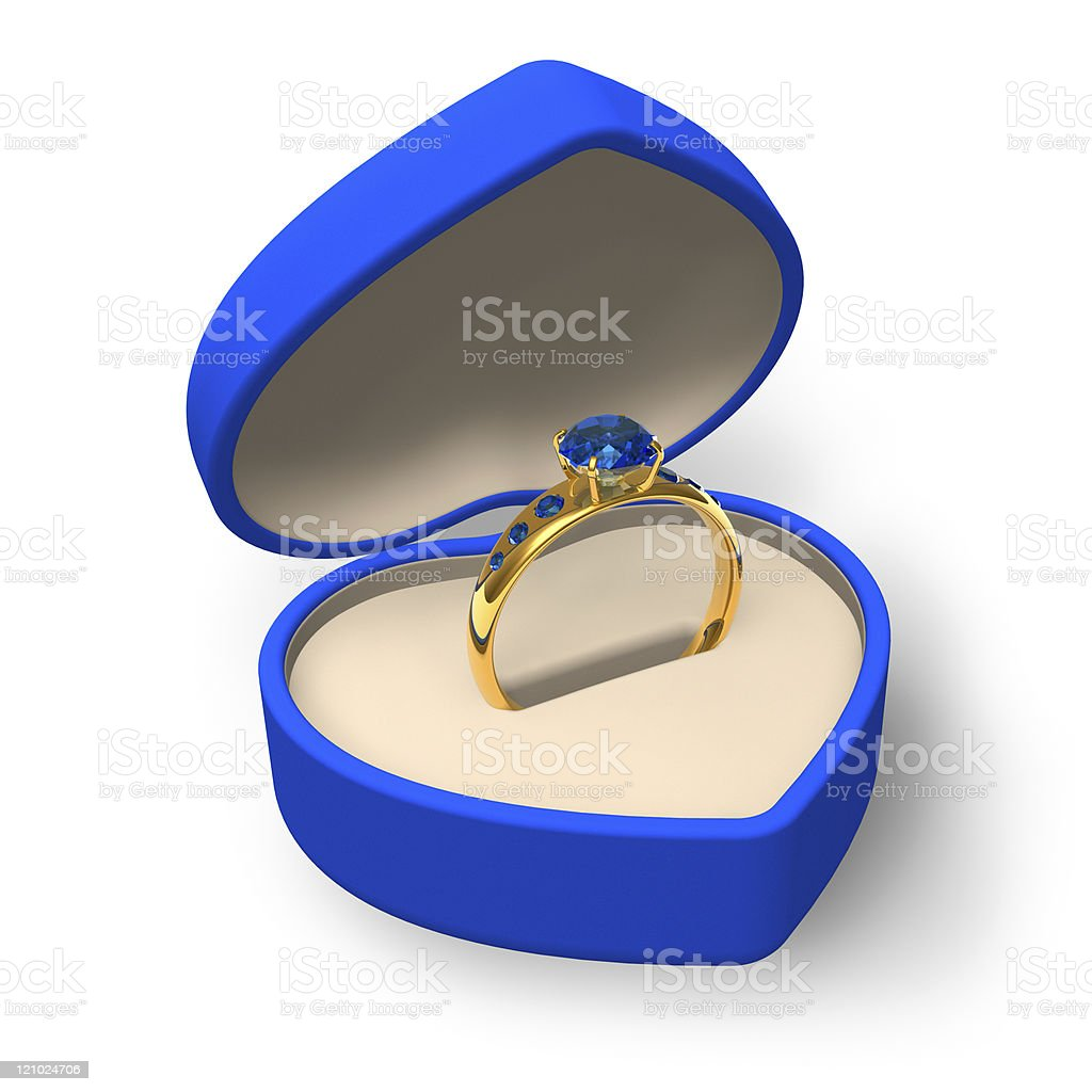 Golden ring with sapphires in blue heart-shape box royalty-free stock photo