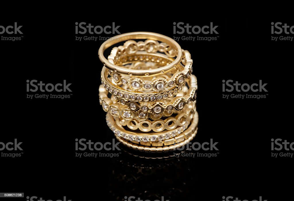 Golden Rings Collection on Black Background stock photo