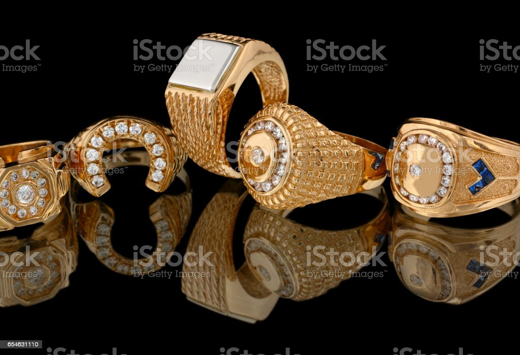 Golden rings with diamonds isolated on black background stock photo