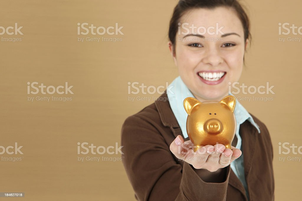 Golden Savings - Piggy Bank in Hands royalty-free stock photo