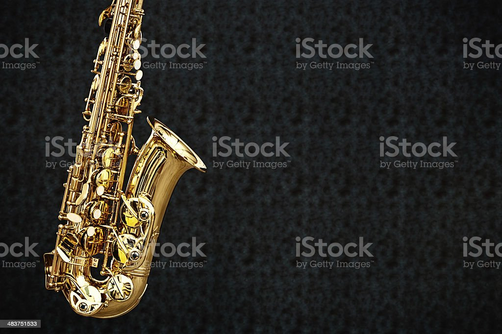 Golden sax on black with copy space royalty-free stock photo