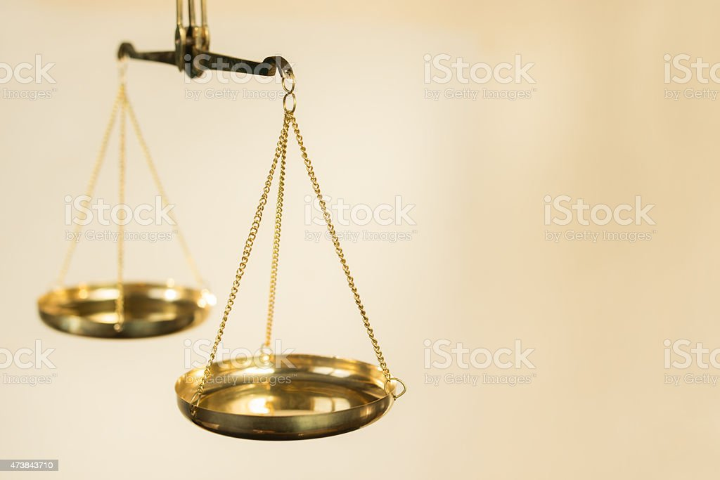 Golden scales stock photo