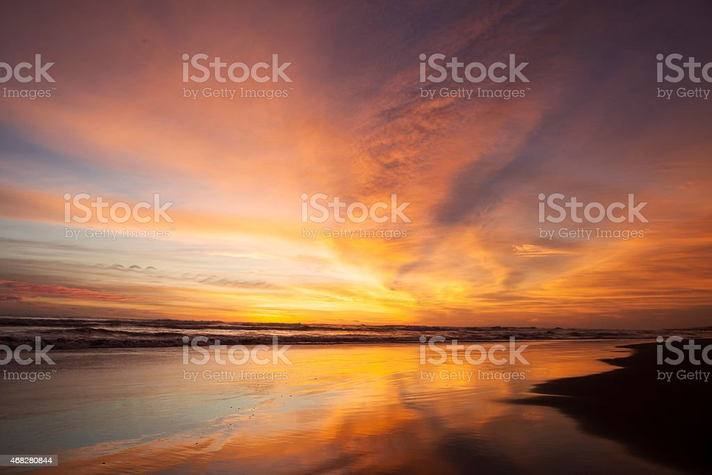 Golden scenery of sunset at beach stock photo