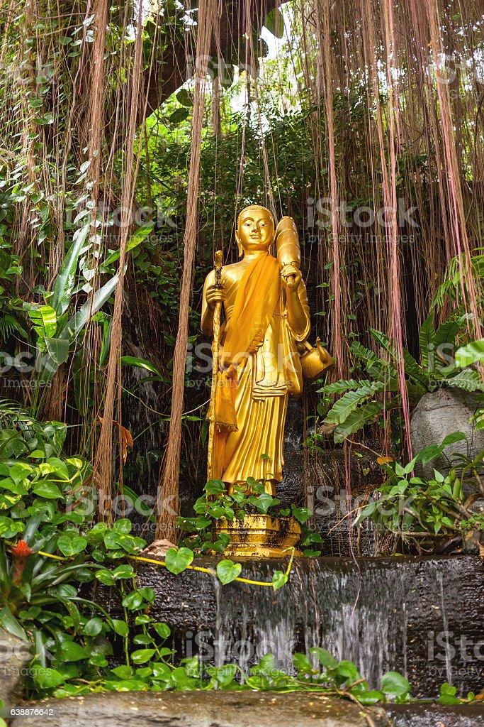 Golden sculpture in bushes. Golden mount (Wat Saket), Bangkok, Thailand. stock photo