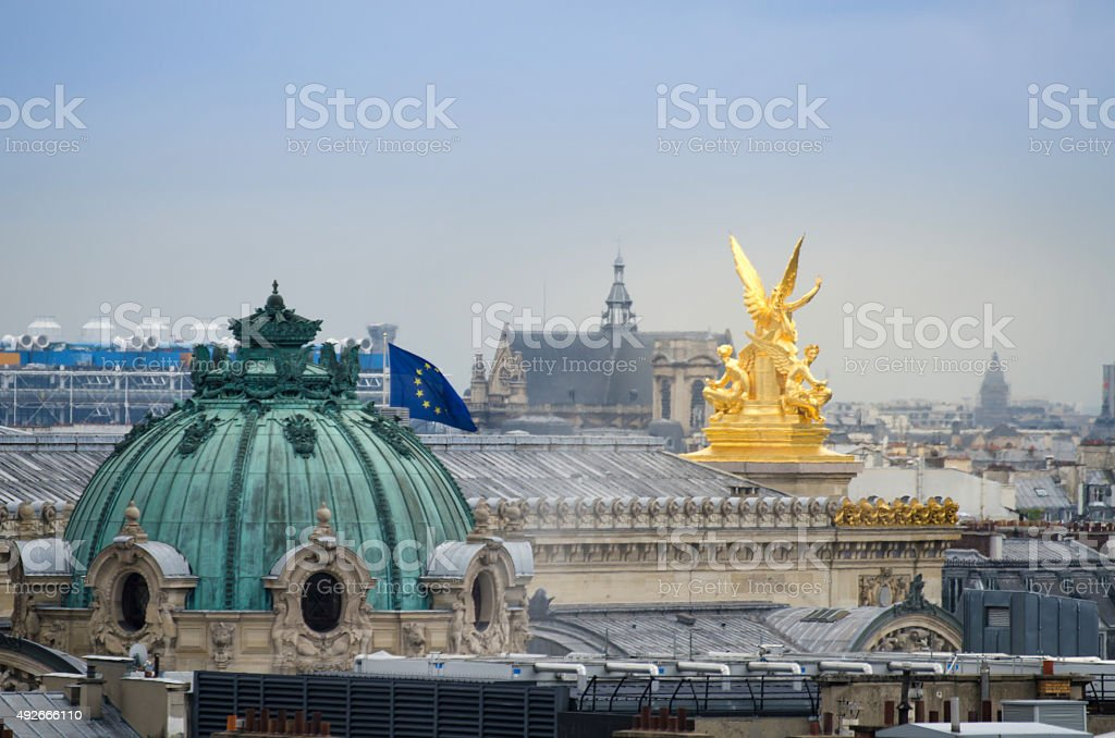 Golden sculpture with beautiful Paris skyline stock photo