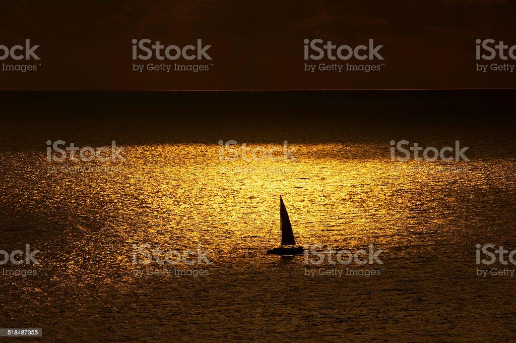 Golden sea at sunset stock photo