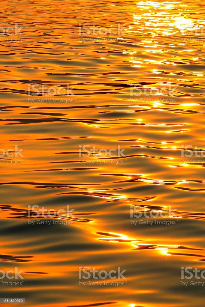 golden sea during sunset stock photo