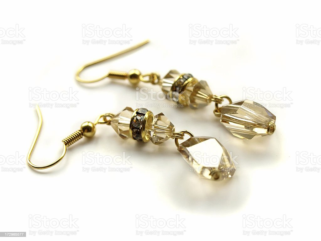 Golden shade swarovski crystal gold earrings stock photo