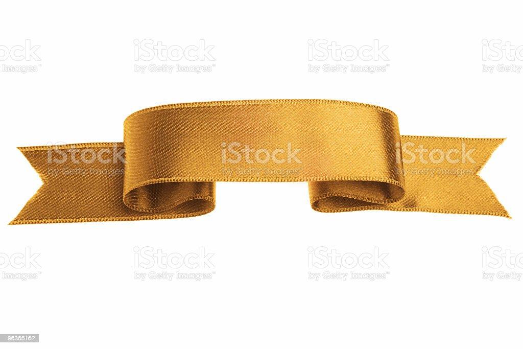 Golden silk ribbon banner on white background stock photo